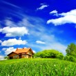 Stock Photo: New house on cloudy sky