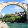 Old bridge in Mostar and river Neretva - Stock Photo