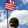 Soldier and American flag - Stock Photo