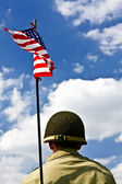 Soldier and American flag — Stok fotoğraf