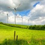 Wind turbines on green field — Stock Photo #3268521