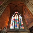 Stained-glass window of St. Vitus Cathedral - Stock Photo