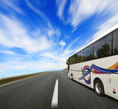 Tour bus with motion blur — Stockfoto