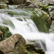 Waterfall on mountain river, long exposure — Stock Photo