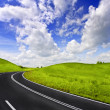 Road and cloudy sky — Stock Photo