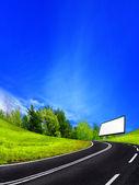 Road and billboard — Stock Photo