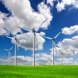 Wind power on green field - Stock Photo