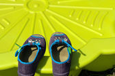 Shoes for children and kid pool — Stock Photo