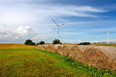 Straw bales and wind turbines — Stock Photo