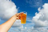 Liquid gold on blue sky — Stock Photo