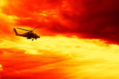 Military helicopter on Sunset — Stockfoto