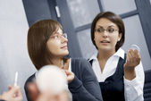 Portrait of young pretty businesswomen in ladies room environment — Stock Photo