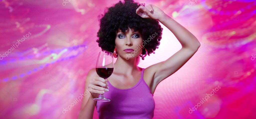 Portrait of young nice woman with glass of wine on pink back  Stock Photo #2778844
