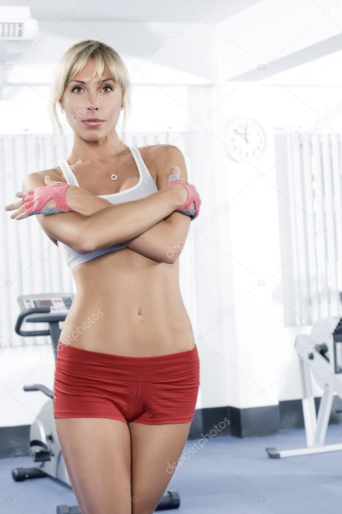 Portrait of young nice woman getting busy in gym     — Stock Photo #2978434