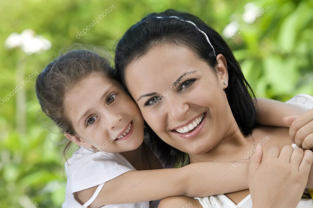 Portrait of happy mother with daughter  having good time in summer environment — Stock Photo #3036199
