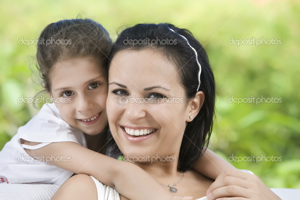 Portrait of happy mother with daughter  having good time in summer environment — Stock Photo #3303965