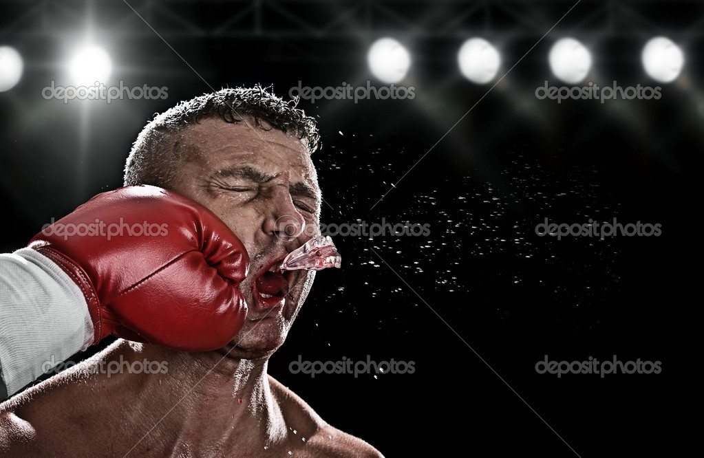 Low key portrait of boxer getting knocked out — Stock Photo #3337475