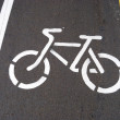 Drawing of a contour of a bicycle on asphalt — Stock Photo
