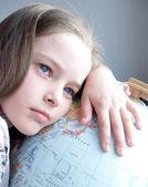 Girl with globe — Stock Photo