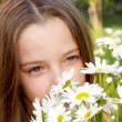 Girl and Daisies — Stock Photo