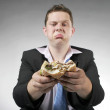 Unhappy businessman showing a bad burger — Stock Photo