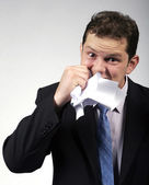Crazy businessman eating paper — Stock Photo