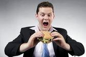 бизнесмен готов съесть его обед — Стоковое фото