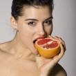 Shocked woman with a grapefruit slice — Stock Photo