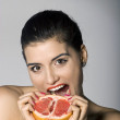 Shocked woman with a grapefruit slice — Stock Photo #2846200