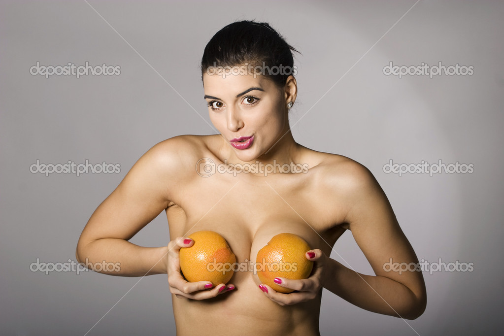 Portrait of a beautiful woman with grapefruit. Studio shots. Part of a series.  Stock Photo #2846095