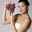 Woman holding red grapes — Stock Photo