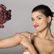 Woman holding red grapes — Stock Photo #2854849