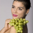 Woman with fresh green grapes — Stock Photo