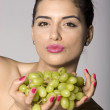 Stock Photo: Woman with fresh green grapes