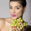 Woman with fresh green grapes — Stock Photo #2855189