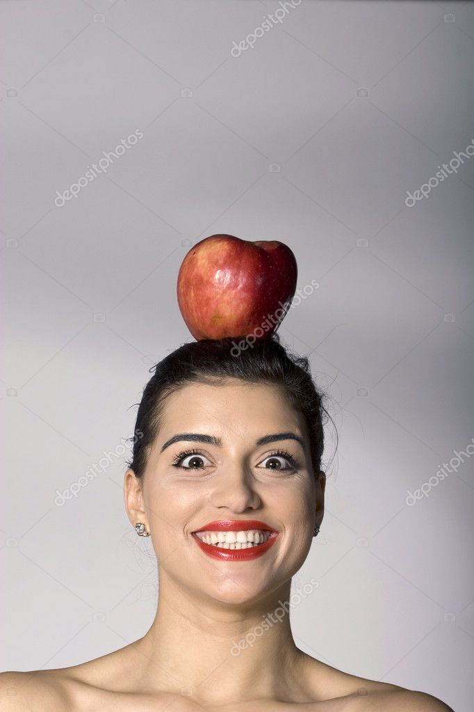 Part of photo series of a woman holding an apple on her head — Stock Photo #2854975
