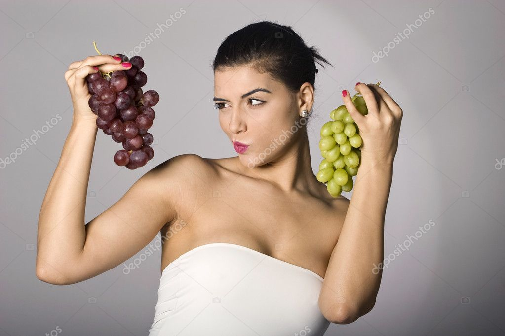 Part of photo series. Woman with mix of grapes. Studio shot — Stock Photo #2855251