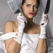 Bridezilla holding knives - Stock Photo
