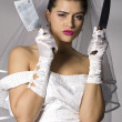 Royalty-Free Stock Photo: Bridezilla holding knives