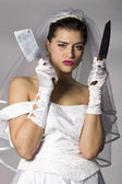 Bridezilla holding knives — ストック写真