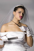 Bridezilla holding knives — Stock Photo