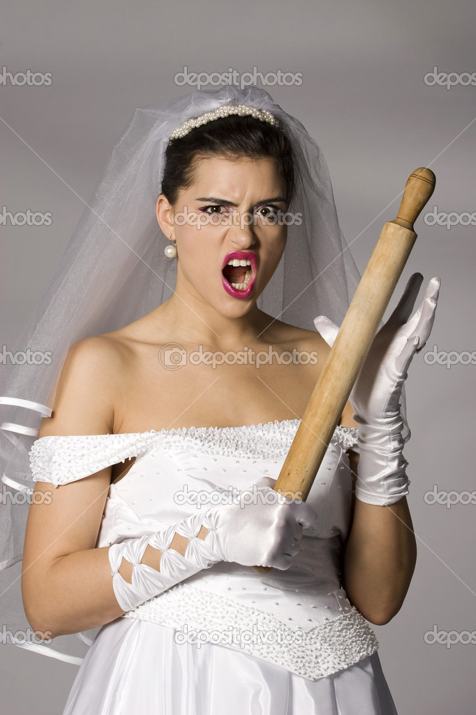 Killer bride photo series. Bridezilla with wooden rolling pin. Studio shot — Stock Photo #2866334