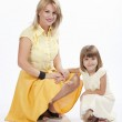 Young beautiful mother and daughter smiling — Stock Photo