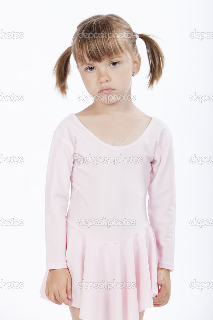 Portrait of a sad little girl wearing pink outfit — Stock Photo #3899822