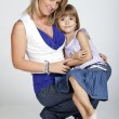 Beautiful young mother and her little daughter smiling — Stock Photo #3900559