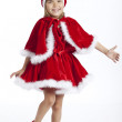 5 years old girl is happy to be Santa's little helper — Stock Photo