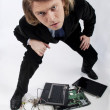 Funny portrait of a businessman with broken laptop — Stock Photo