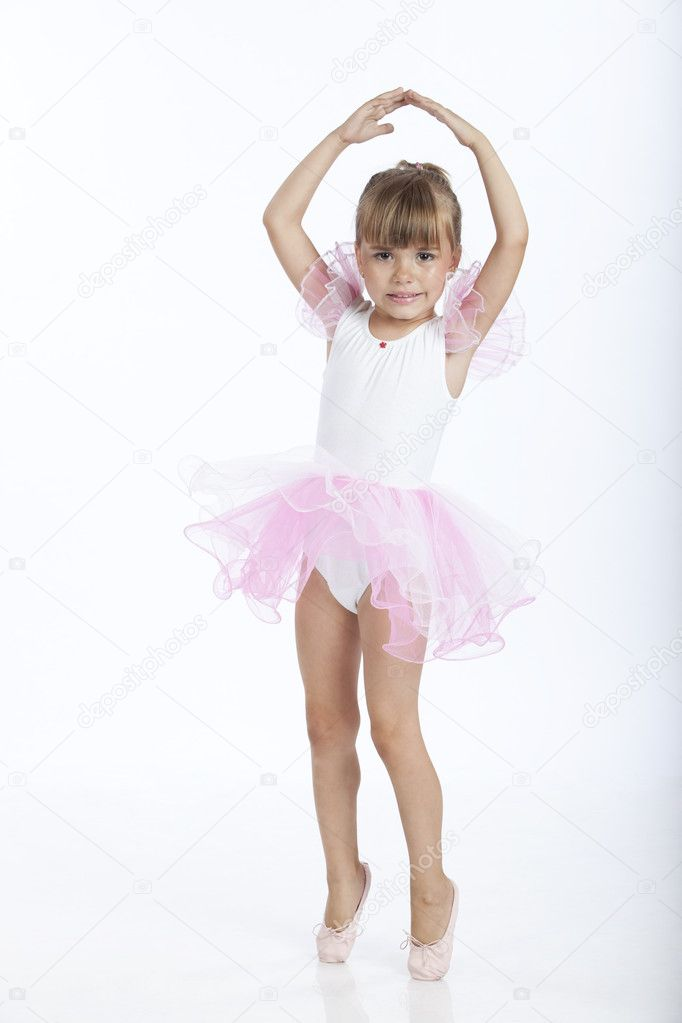 Full length portrait of a little ballerina trying a new ballet position, studio image — Stock Photo #3900573