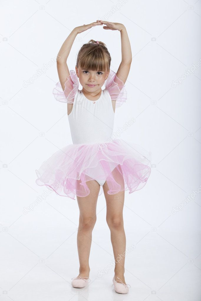 Full length portrait of a little pretty ballerina performing a new ballet position, studio image — Stock Photo #3900581
