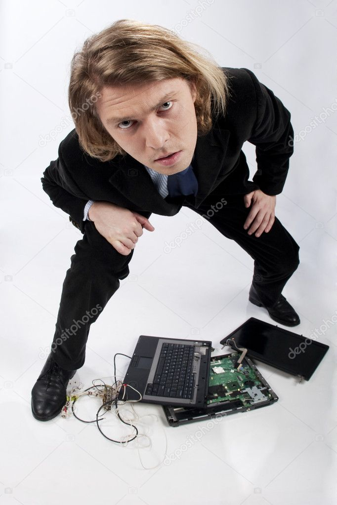 Funny portrait of a businessman with broken laptop, image taken with fish eye lens, in studio — Stock Photo #3902129